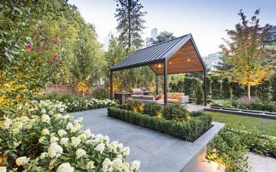 Pavilion, alfresco, fire pit, paving, plants, lawn, feature tree, pergola, outdoor kitchen.